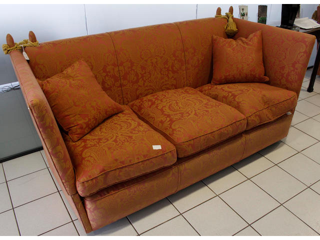 A pair of three seater Knowle type settees, each with feather filled loose cushions in red damask.