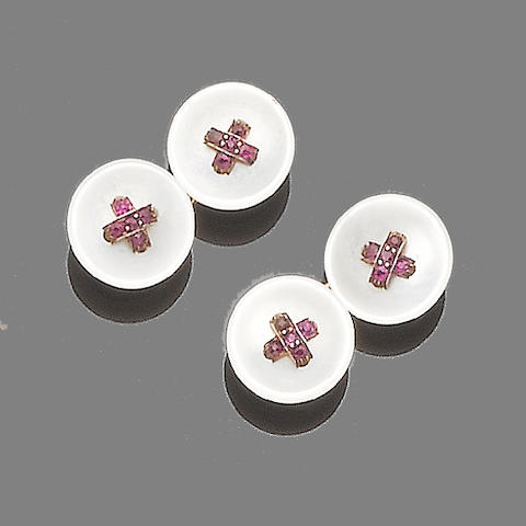 A pair of mother-of-pearl and ruby cufflinks
