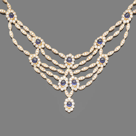 A sapphire and diamond necklace and bracelet suite (2)