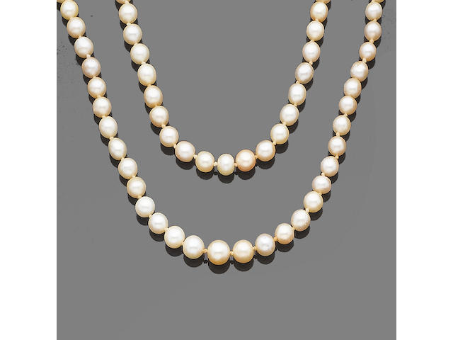 A two-strand pearl and cultured pearl necklace with diamond clasp