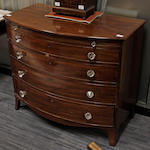 A late regency mahogany bow front chest,
