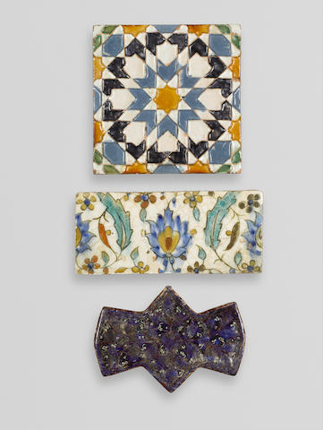A moulded Lajvardina tile Iran, 12th century