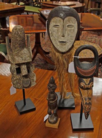 "A Lega mask, Zaire,57cm high, a Dragon Leopard mask, Mali, with ""snake"" like profusion atop its head, 33cm high, a Mozzi/Nunuma mask, Burkina Faso, with long curved beak, 36cm high and a Yaka figure, Zaire,27cm high. (4)"
