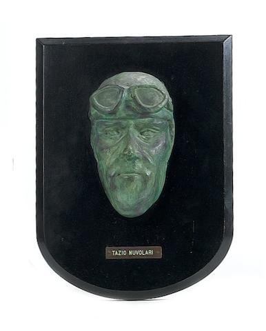A cast bronze mask sculpture of Tazio Nuvolari,