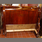 A French mahogany 4' bateau lit, with shaped panel ends.