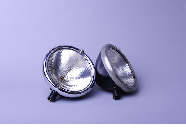 A pair of Bosch headlamps,