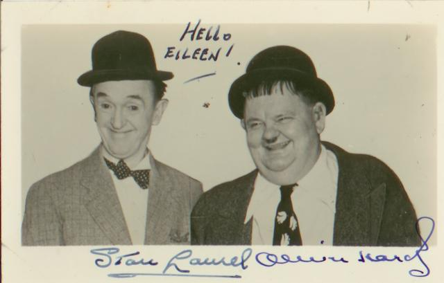 A Laurel and Hardy autographed postcard,