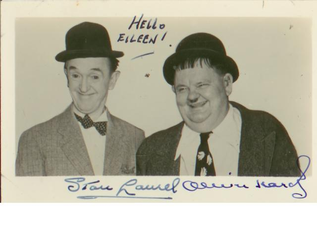 A Laurel and Hardy autographed postcard