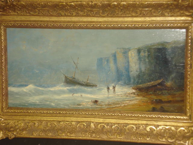 British School (circa 1886) Shore scene with figures before a beached ship by cliffs