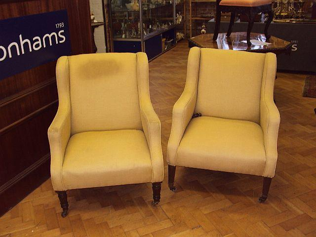 Two mahogany-framed upholstered armchairs, early 20th Century