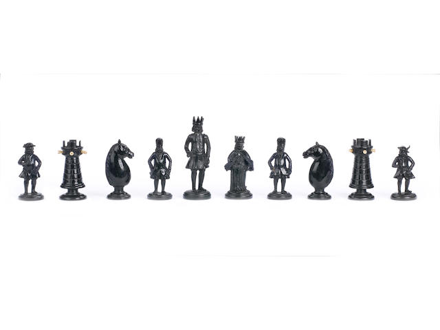 An ivory and ebony figural chess set South German, early 18th century