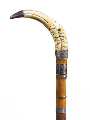"An Edwardian 9 carat gold mounted ivory, warthog tusk and silver walking cane, the mount with maker's mark incuse ""G.L"", Birmingham 1908,"