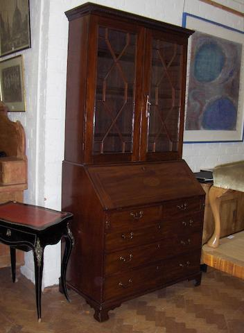 A George III mahogany and inlaid bureau bookcase