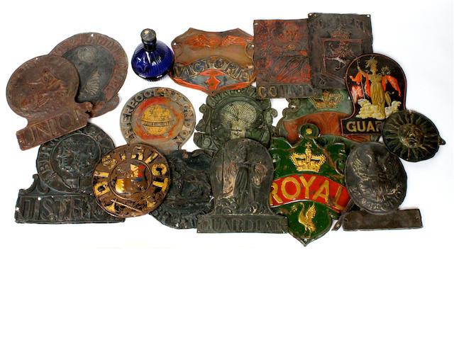 Sixteen various tin firemarks: