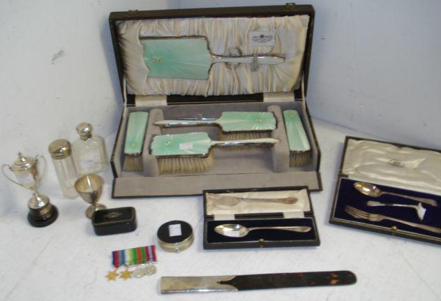 A cased six piece Art Deco silver mounted pale green guilloche enamel dressing table set, Birmingham 1937, two silver mounted glass toilet bottles, silver mounted tortoiseshell paper knife, marks rubbed, child's cased silver spoon, fork and pusher, child's cased silver spoon and matching fork, silver egg cup and miniature trophy, also two snuff boxes, and a set of second World War medal miniatures.