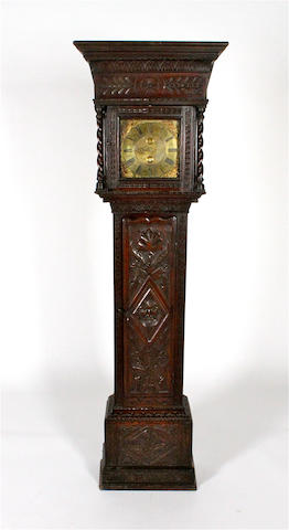 An early 18th century and later oak thirty hour longcase clock