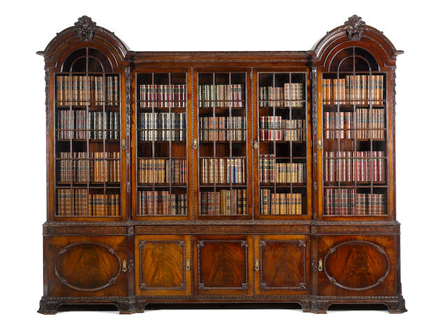 A good and large Edwardian 18th century design figured mahogany library bookcase stamped 'Gillow'