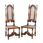 A pair of William & Mary-style oak and cane high-back side chairs