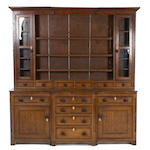A George III oak and line inlaid breakfront high dresser