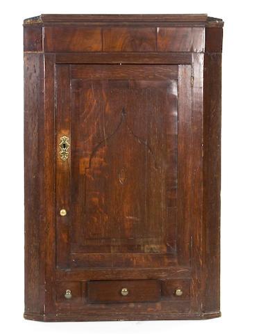A 19th Century oak and mahogany mural corner cupboard