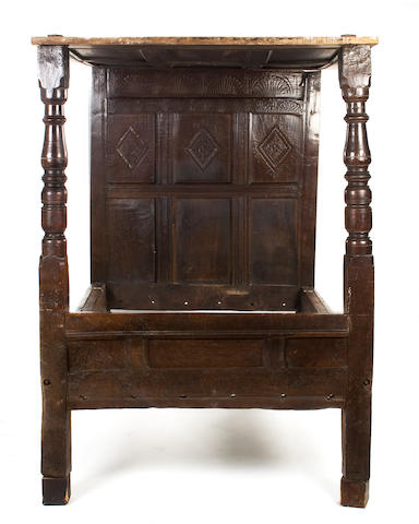 A Charles II oak tester bed