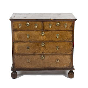 A William and Mary walnut inlaid chest of drawers