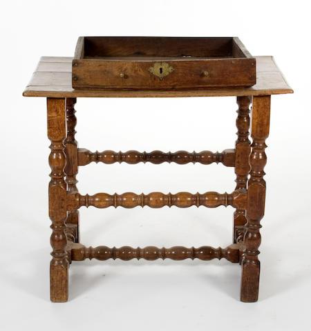 A Charles II oak side table