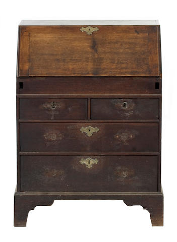 An unusually small early 18th Century oak bureau