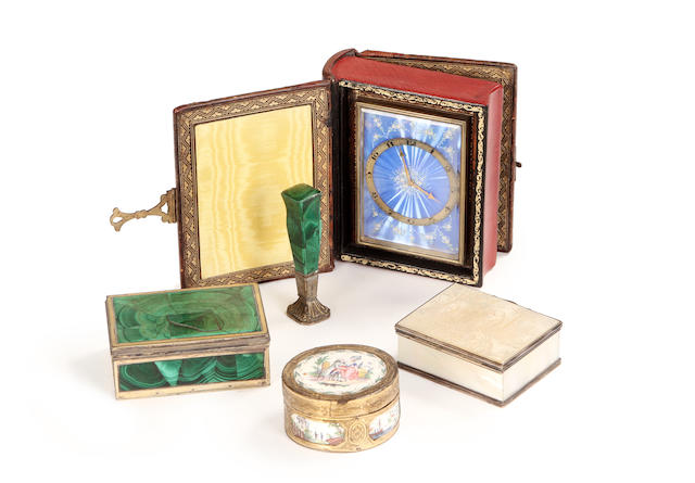 An early 20th century table top clock in a faux book case together with four other items