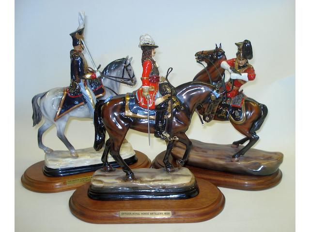 A group of three limited edition Michael Sutty figures on horseback