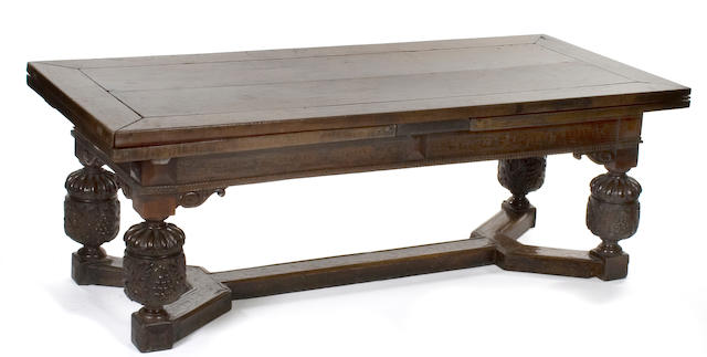 A rare early 17th century walnut and marquetry draw leaf refectory table Provenance: Earl of Derby, Knowsley Hall, Prescott, Merseyside. Purchased by the present vendor in the 1960s