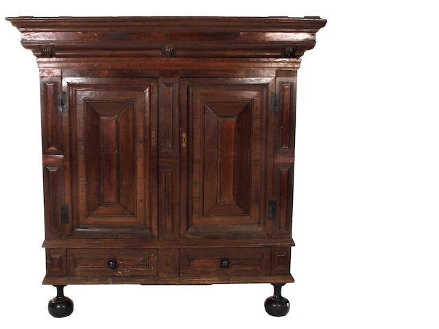 A late 17th Century oak and fruitwood geometric moulded armoire, Dutch