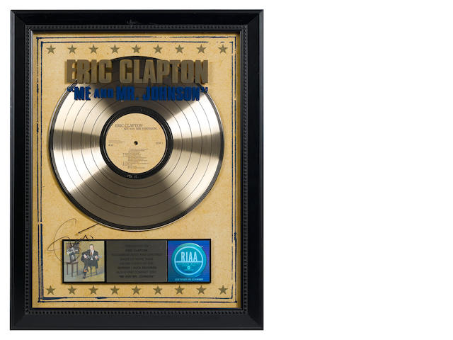 A presentation 'gold' sales award for the Reprise/Duck Records LP ME AND MR JOHNSON,  RIAA certified – Presented to ERIC CLAPTON,
