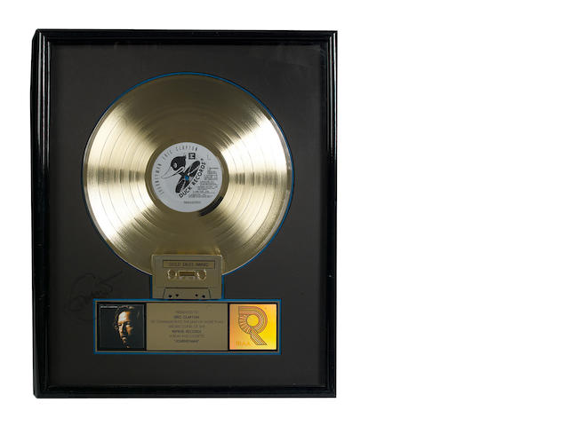 A presentation 'gold' sales award for the Reprise/Duck Records LP JOURNEYMAN, RIAA certified – Presented to ERIC CLAPTON,