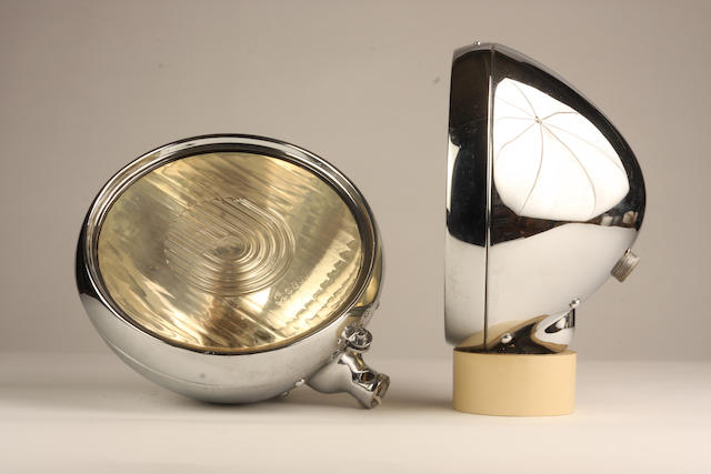 A pair of Bosch electric headlamps,