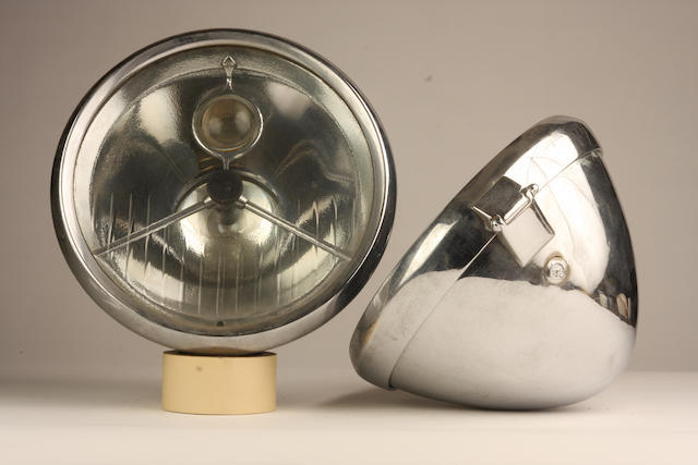 A pair of Lucas P100 electric headlamps with bulls-eye,