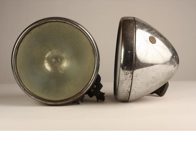 A pair of Lucas Type 165S headlamps,