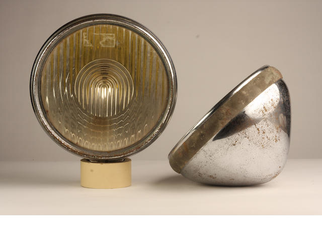 A pair of large Bosch headlamps