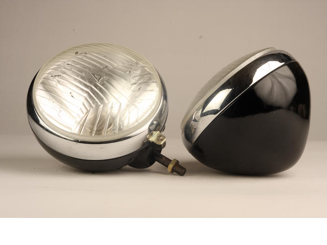 A pair of Autoroche electric headlamps,