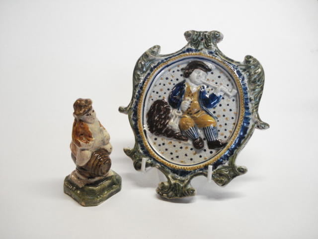 A prattware plaque of a gaoler or cellarer, circa 1800