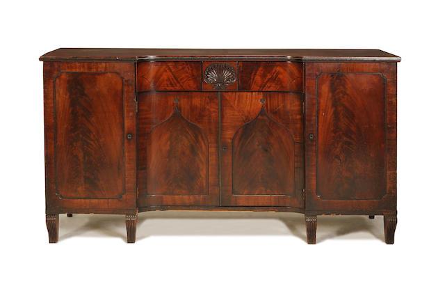 A Regency ebony line inlaid mahogany sideboard
