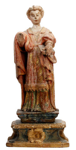 An 18th Century painted softwood figure of a female saint