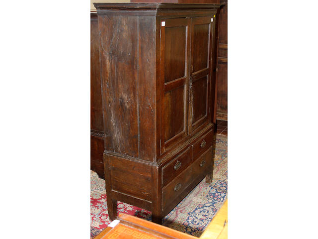 A George III oak press cupboard,
