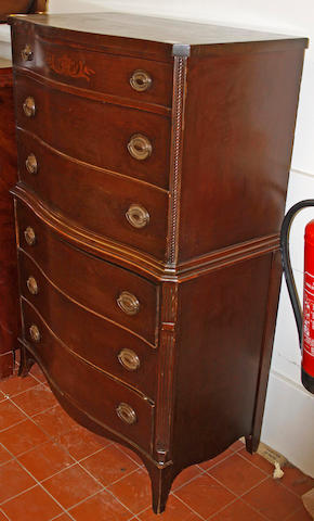 A reproduction mahogany serpntine tallboy,