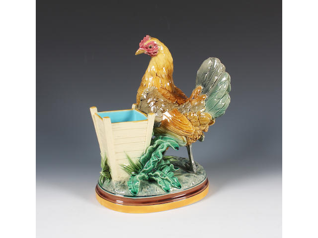 A Minton majolica spill vase modelled as a hen by John Henk Dated 1876.
