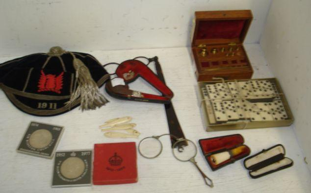 A large collection of 19th Century gaming counters, in the form of ivory fish with painted detail, part set of dominoes, walnut cased set of brass weights, two pairs of lorgnettes, one tortoiseshell, cased pipe and cigarette holders, Commemorative Crowns and other coins and a 1911 Rugby cap.