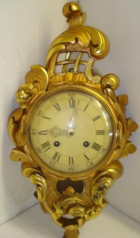 A Swedish carved giltwood Cartel clock, in 18th Century style, the 8 day movement striking on a bell, 52cm.