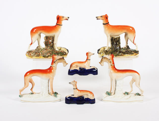 Two pairs of Staffordshire models of greyhounds and a small pair of greyhound quill holders Mid 19th Century.