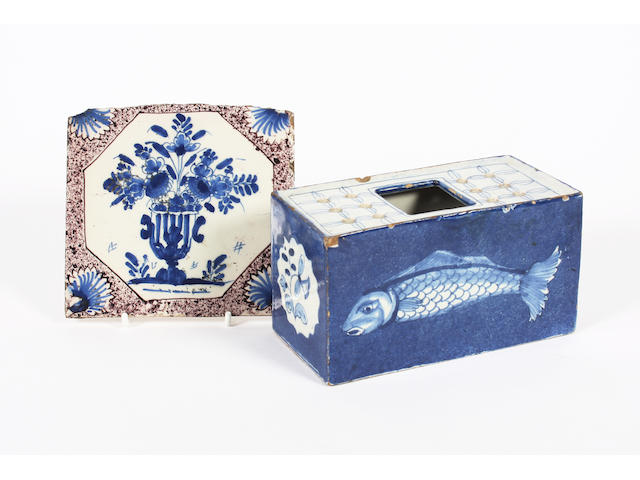 A Bristol delft flower brick and a tile Circa 1750.