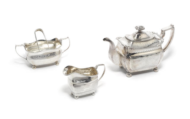 A George III Irish silver matched three-piece tea service and pair of sugar tongs, teapot, maker's mark mistruck, Dublin 1814, cream jug and sugar bowl, maker's mark rubbed, Dublin 1809, sugar tongs, Hibernia and town mark only,  (4)